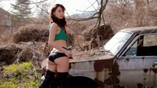 Spunked sexy and hot Japanese Rina Akiyama poses near the car
