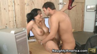 Flexible brunette Zoey Holloway lifts her leg up to stretch her pussy