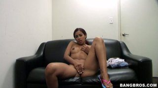 Kinky redhead Julissa James masturbates on a couch fingering her pussy and later gives a head to the interviewer