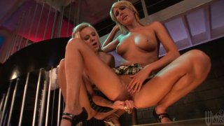 Two slutty blondes Cali Kayden and Victoria White get lesbie on the dance stage