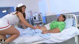 Curvaceous nurse Eliska Cross treats her patient with blowjob