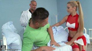 Sexy blonde nurse Bibi Noel sucks two dicks at the hospital